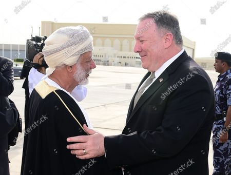 US Secretary of State Mike Pompeo (R) is welcomed by Omani Minister of Foreign Affairs Yusuf bin Alawi bin Abdullah (L) upon his arrival at an airport in Muscat, Oman, 21 February 2020. Pompeo is in on an official visit to Oman, where he is expected to meet with Sultan Haitham bin Tariq.