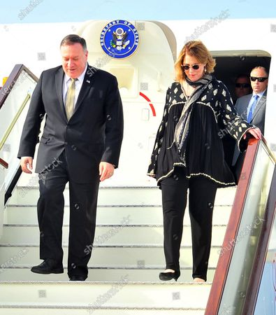 US Secretary of State Mike Pompeo (L) and his wife Susan arrive at an airport in Muscat, Oman, 21 February 2020. Pompeo is in on an official visit to Oman, where he is expected to meet with Sultan Haitham bin Tariq.