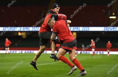 Ross Moriarty hits a tackle bag held by Sam Warburton during training.