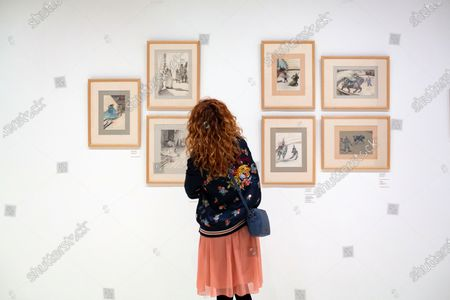 A woman looks at some of the works displayed at the exhibition 'Toulouse-Lautrec and the circus' in the Carmen Thyssen Museum in Malaga, Spain, 21 February 2020. The exhibition will be open to public from 21 February to 07 June 2020.