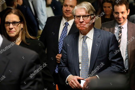 Cyrus Vance Jr., Joan Illuzzi. Manhattan District Attorney Cyrus Vance Jr, foreground right, accompanied by Assistant District Attorney Joan Illuzzi, leaves the courtroom after Harvey Weinstein's rape trial adjourned for the day, in New York,. The jury in Weinstein's trial indicated Friday that it is deadlocked on the most serious charges against the once powerful Hollywood mogul, but the judge told the panel it must keep working