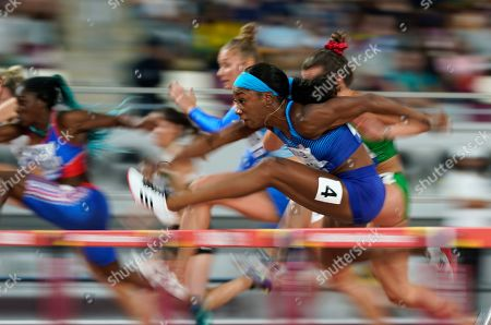Kendra Harrison, (4) of the United States, competes in a heat of the women's 100 meter hurdles at the World Athletics Championships in Doha, Qatar. The photo was part of a series of images by photographer David J. Phillip which won the Thomas V. diLustro best portfolio award for 2019 given out by the Associated Press Sports Editors during their annual winter meeting in St. Petersburg, Fla
