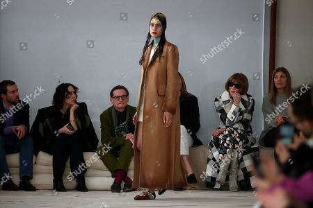 Anna Wintour, second from right, looks at a model wearing a creation as part of Marni's Fall/Winter 2020/2021 collection, presented in Milan, Italy