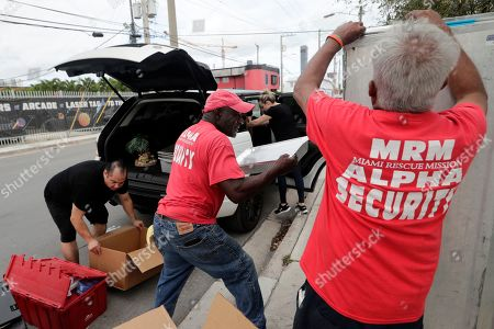 Julio Yon, William Friday. Julio Yon, left, owner of Cuban Boys, and William Friday, center, of the Miami Rescue Mission, unload food for the burger bash competition at the Miami Rescue Mission in Miami. From Rachael Ray to Bobby Flay, the biggest names in the culinary world are in Miami starting Thursday for the South Beach Wine and Food Festival. And they're getting help in their prep kitchen from an unlikely source, a local homeless shelter. The festival partnered with the Miami Rescue Mission and Florida International University's culinary school