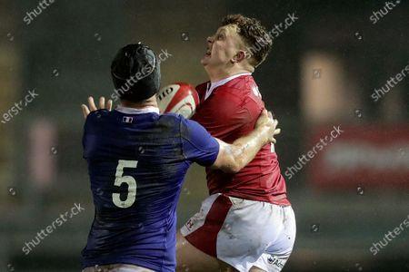 Wales U20 vs France U20. Wales' Aneurin Owen and Joshua Brennan of France