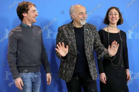 Giorgio Diritti (C), Elio Germano (L) and writer Tania Pedroni pose during the 'Volevo Nascondermi' (Hidden Away) photocall during the 70th annual Berlin International Film Festival (Berlinale), in Berlin, Germany, 21 February 2020. The movie is presented in the Official Competition at the Berlinale that runs from 20 February to 01 March 2020.