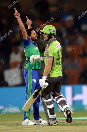 Shahid Afridi (L) of Lahore Qalandars celebrates the dismissal of Ben Dunk of Multan Sultans, during the Pakistan Super League (PSL) T20 series cricket match between Lahore Qalandars and Multan Sultans, in Lahore, Pakistan, 21 February 2020.