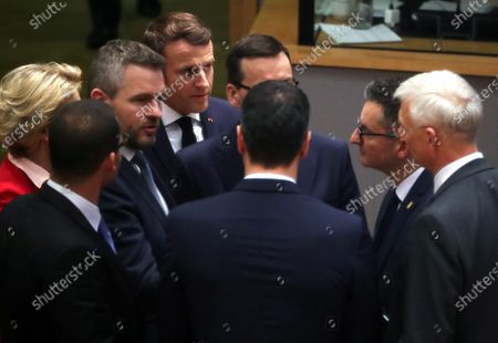 France's President Emmanuel Macron (4-L), Slovenia's Prime Minister Marjan Sarec (2-R), Slovak Prime Minister Peter Pellegrini (3-L), Poland's Prime Minister Mateusz Morawiecki (C) and Latvia's Prime Minister Krisjanis Karins (R) attend the second day of a special European Council summit in Brussels, Belgium, 21 February 2020. EU heads of state or government gather for a special meeting to discuss the EU's long-term budget for 2021-2027.