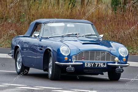 Prince Charles arrives in his 1960 Aston Martin DB6