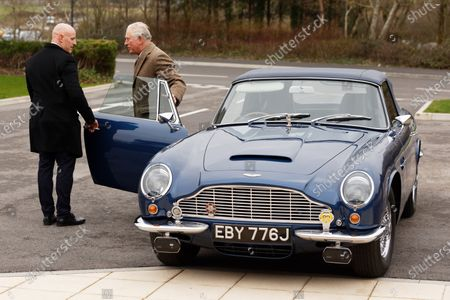 Prince Charles arrives in his 1960 Aston Martin DB6 Volante
