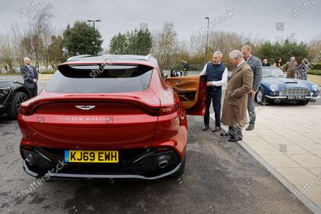 Prince Charles is shown a brand new Aston Marytin DBX