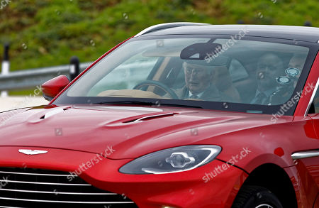 Prince Charles in the driving seat of a brand new Aston Martin DBX