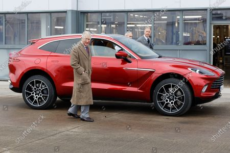 Prince Charles exits a brand new Aston Martin DBX