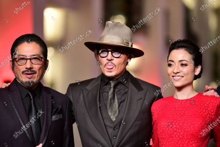 Hiroyuki Sanada, Johnny Depp, and Minami arrive for the premiere of 'Minamata' during the 70th annual Berlin International Film Festival (Berlinale), in Berlin, Germany, 21 February 2020. The movie is presented in the Berlinale Special section at the Berlinale that runs from 20 February to 01 March 2020.