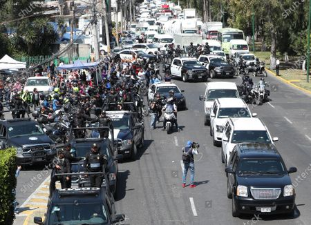 Stock Image of General view of the convoy that transfers the alleged murderers of 7-year-old girl  Fatima, in the municipality of Atizapan de Zaragoza, in the State of Mexico, Mexico 21 February 2020. A Mexican judge issued arrest warrants for aggravated kidnapping and femicide against Giovana and Mario Alberto, suspects in the sexual assault and murder of Fatima in Mexico City.