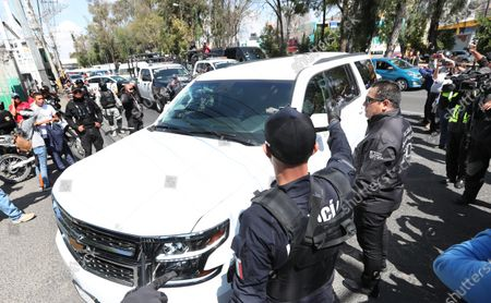General view of the convoy that transfers the alleged murderers of 7-year-old girl  Fatima, in the municipality of Atizapan de Zaragoza, in the State of Mexico, Mexico 21 February 2020. A Mexican judge issued arrest warrants for aggravated kidnapping and femicide against Giovana and Mario Alberto, suspects in the sexual assault and murder of Fatima in Mexico City.