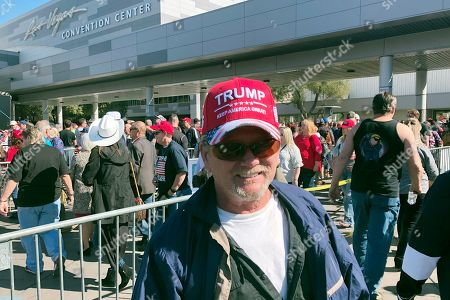 Jim Chapman, 60, a retired construction worker from Pahrump, Nev., talks, about President Donald Trump while waiting to enter a Republican political rally at the Las Vegas Convention Center in Las Vegas. Organizers expected thousands of Trump supporters for the event a day before Democratic party caucuses in Nevada