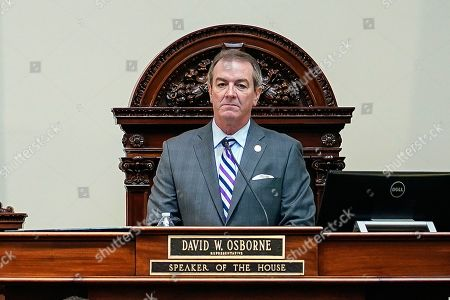 Stock Photo of Kentucky Republican Speaker of the House David Osborne stands at his desk on the floor of the House at the Capitol in Frankfort, Ky. A politically divisive proposal to revamp Kentucky's public assistance programs and tighten enforcement to prevent fraud won passage in the Republican-run state House on Friday. The bill's lead sponsors are the House's top two Republican leaders, House Speaker David Osborne and House Speaker Pro Tem David Meade