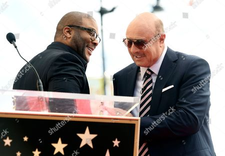 Phil McGraw, Tyler Perry. Talk show host Dr. Phil McGraw, right, greets guest speaker Tyler Perry onstage during a ceremony to award MGraw a star on the Hollywood Walk of Fame, in Los Angeles