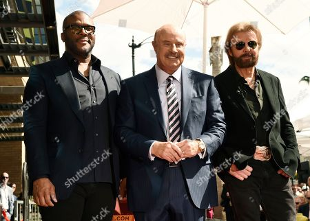 Dr. Phil McGraw, Tyler Perry, Ronnie Dunn. Talk show host Dr. Phil McGraw, center, poses with guest speakers Tyler Perry, left, and Ronnie Dunn during a ceremony to award McGraw a star on the Hollywood Walk of Fame, in Los Angeles