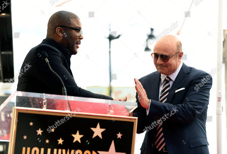 Phil McGraw, Tyler Perry. Talk show host Dr. Phil McGraw, right, shakes hands with guest speaker Tyler Perry during a ceremony to award McGraw a star on the Hollywood Walk of Fame, in Los Angeles
