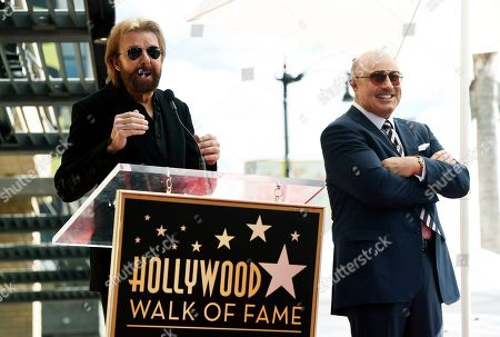 Phil McGraw, Ronnie Dunn. Guest speaker Ronnie Dunn, left, addresses the audience as honoree Dr. Phil McGraw looks on during a ceremony to award McGraw a star on the Hollywood Walk of Fame, in Los Angeles