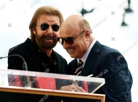 Dr. Phil McGraw, Ronnie Dunn. Guest speaker Ronnie Dunn, left, greets honoree Dr. Phil McGraw onstage during a ceremony to award McGraw a star on the Hollywood Walk of Fame, in Los Angeles