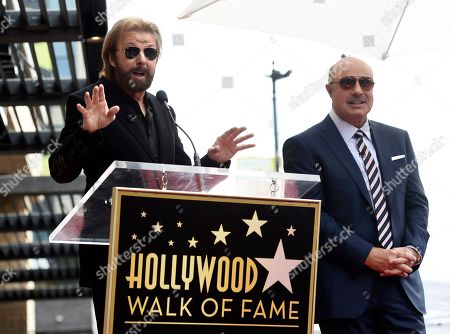 Dr. Phil McGraw, Ronnie Dunn. Guest speaker Ronnie Dunn, left, addresses the crowd as honoree Dr. Phil McGraw looks on during a ceremony to award McGraw a star on the Hollywood Walk of Fame, in Los Angeles