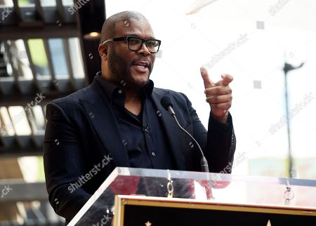 Guest speaker Tyler Perry addresses the crowd during a ceremony to award Dr. Phil McGraw a star on the Hollywood Walk of Fame, in Los Angeles