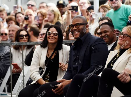 Guest speaker Tyler Perry, second from right, looks on during a ceremony to award talk show host Dr. Phil McGraw a star on the Hollywood Walk of Fame, in Los Angeles
