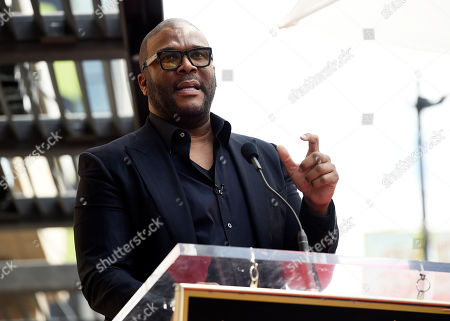 Guest speaker Tyler Perry addresses the crowd during a ceremony to award talk show host Dr. Phil McGraw a star on the Hollywood Walk of Fame, in Los Angeles
