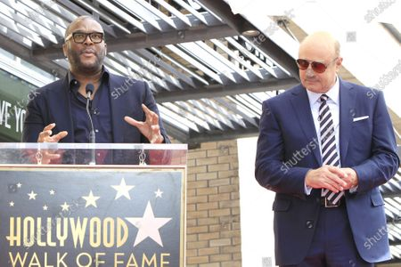 Tyler Perry (L) and Dr Phil McGraw at a ceremony honoring Dr. Phil with the 2688th star on the Hollywood Walk of Fame in Los Angeles, California, USA, 21 February 2020. The star is dedicated in the category of Television.