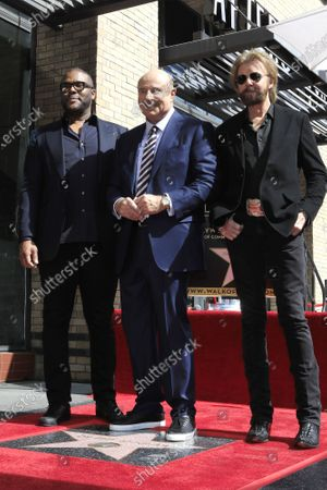 Tyler Perry (L), Dr. Phil McGraw (C) and US singer Ronnie Dunn (R) at a ceremony honoring Dr. Phil with the 2688th star on the Hollywood Walk of Fame in Los Angeles, California, USA, 21 February 2020. The star is dedicated in the category of Television.