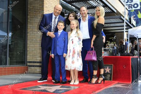 Stock Photo of Dr. Phil McGraw, his wife Robin McGraw, their son Jay McGraw and his wife Erica Dahm, grandson London and granddaughter Avery (both in front) at a ceremony honoring Dr. Phil with the 2688th star on the Hollywood Walk of Fame in Los Angeles, California, USA, 21 February 2020. The star is dedicated in the category of Television.