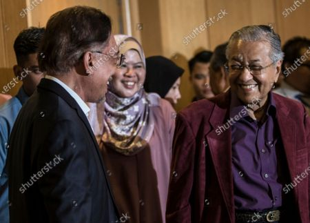 Malaysian Prime Minister Mahathir Mohamad (R) and prime minister in-waiting Anwar Ibrahim smiles after a press conference after the Pakatan Harapan presidential council meeting in Putrajaya, Malaysia, early 22 February 2020. Mahathir said its up to him to decide when to step down as prime minister after Pakatan Harapan presidential council made a unanimous decision to allow him to set the date.