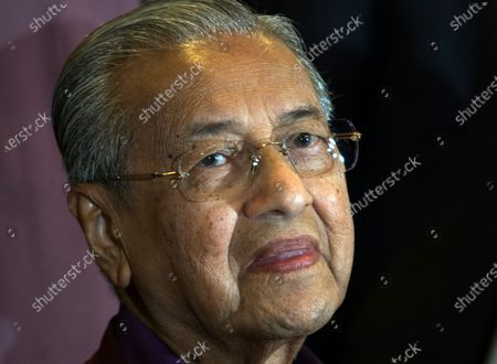 Malaysian Prime Minister Mahathir Mohamad smiles at a press conference after the Pakatan Harapan presidential council meeting in Putrajaya, Malaysia, early 22 February 2020. Mahathir said its up to him to decide when to step down as prime minister after Pakatan Harapan presidential council made a unanimous decision to allow him to set the date.