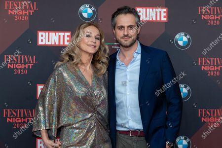 Caroline Beil (L) and her husband Philipp Sattler (R) pose at the red carpet of Festival Night by Bunte and BMW as a part of Berlinale in Berlin, Germany, 21 February 2020.