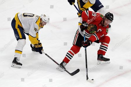 Jonathan Toews, Colton Sissons. Chicago Blackhawks center Jonathan Toews, right, controls the puck against Nashville Predators center Colton Sissons during the second period of an NHL hockey game in Chicago
