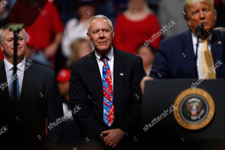 R m. U.S. Rep. Ken Buck, R-Colo., listens as President Donald Trump speaks at a campaign rally, in Colorado Springs, Colo
