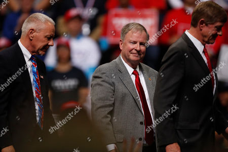 R m. U.S. Rep. Doug Lanborn, R-Colo., joins U.S. Rep. Ken Buck, R-Colo., left, and U.S. Rep. Scott Tipton, R-Colo., off the stage as President Donald Trump speaks at a campaign rally, in Colorado Springs, Colo