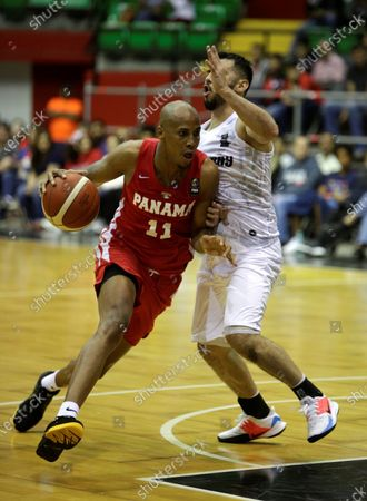 Ernesto Oglivie (L) of Panama in action against Edgar Riveros (R) of Paraguay during the FIBA qualifying tournament for the AmeriCup 2021, at the Roberto Duran Arena in Panama City, Panama, 21 February 2020.