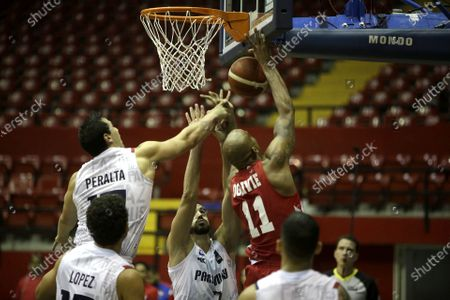 Stock Image of Ernesto Oglivie (R) of Panama in action against Alejandro Peralta (L) of Paraguay during the FIBA qualifying tournament for the AmeriCup 2021, at the Roberto Duran Arena in Panama City, Panama, 21 February 2020.