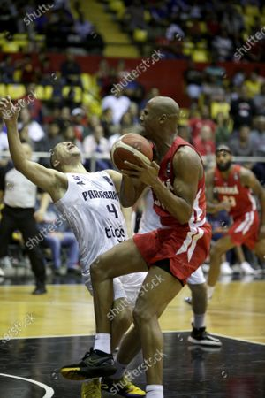 Ernesto Oglivie (R) of Panama in action against Gabriel Peralta (L) of Paraguay during the FIBA qualifying tournament for the AmeriCup 2021, at the Roberto Duran Arena in Panama City, Panama, 21 February 2020.