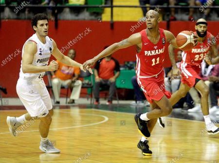 Ernesto Oglivie (R) of Panama in action against Adolfo Lopez (L) of Paraguay during the FIBA qualifying tournament for the AmeriCup 2021, at the Roberto Duran Arena in Panama City, Panama, 21 February 2020.