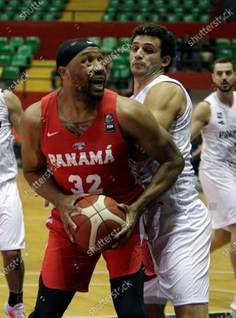 Javier Carter (L) of Panama in action against Adolfo Lopez (R) of Paraguay during the FIBA qualifying tournament for the AmeriCup 2021, at the Roberto Duran Arena in Panama City, Panama, 21 February 2020.