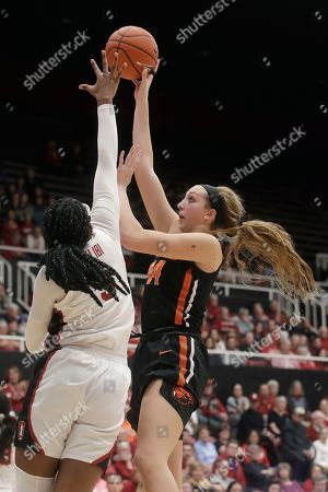Oregon State forward Taylor Jones, right, shoots against Stanford forward Francesca Belibi during the second half of an NCAA college basketball game in Stanford, Calif