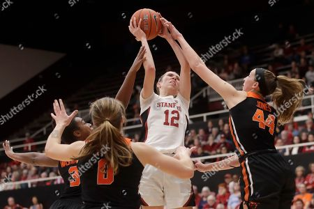 Stanford guard Lexie Hull (12) shoots between Oregon State guard Madison Washington, left, guard Mikayla Pivec (0) and forward Taylor Jones (44) during the second half of an NCAA college basketball game in Stanford, Calif
