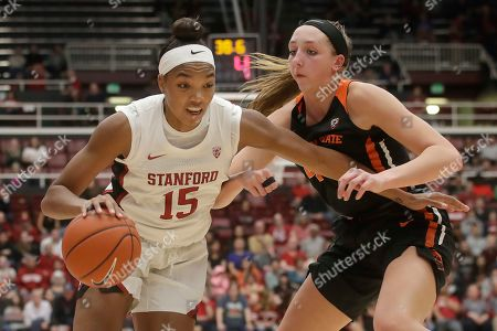 Stanford forward Maya Dodson (15) drives against Oregon State forward Taylor Jones during the second half of an NCAA college basketball game in Stanford, Calif