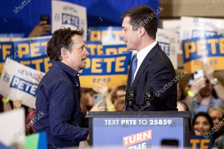 US Democratic Party presidential candidate and former South Bend Mayor Pete Buttigieg (R) shakes hands with US-Canadian actor Michael J. Fox (L) during a campaign rally at Faiss Middle School in Las Vegas, Nevada, USA, 21 February 2020. The Nevada caucus will be held on 22 February.