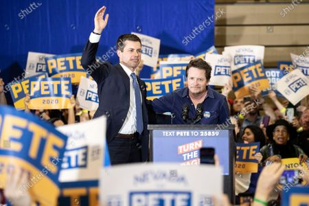 US Democratic Party presidential candidate and former South Bend Mayor Pete Buttigieg (L) takes the stage next to US-Canadian actor Michael J. Fox (R) during a campaign rally at Faiss Middle School in Las Vegas, Nevada, USA, 21 February 2020. The Nevada caucus will be held on 22 February.
